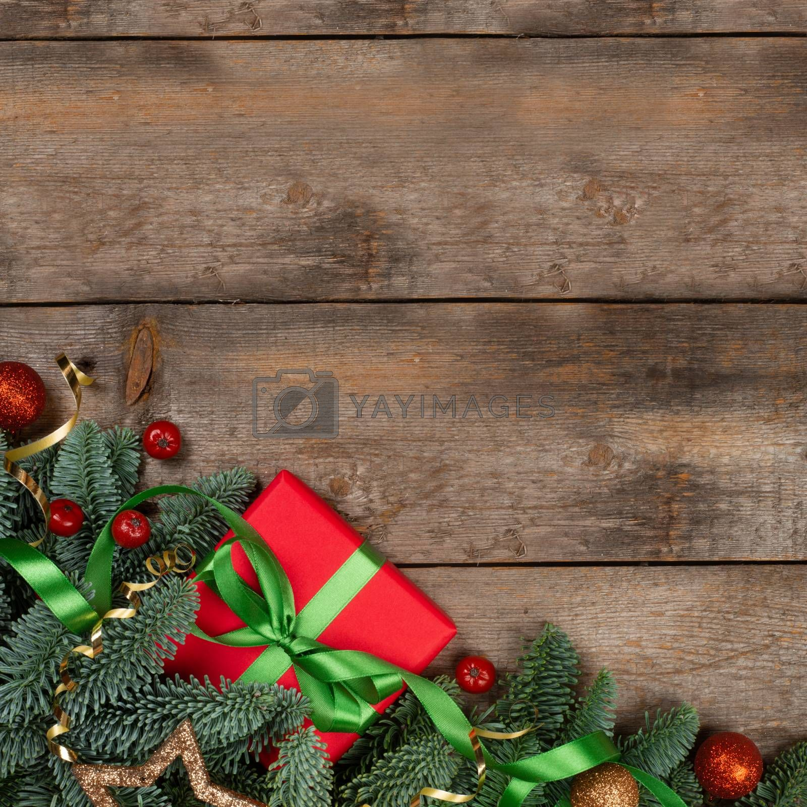 Christmas or New Year background composition made of Xmas decorations and fir tree branches and gift with copy space for text