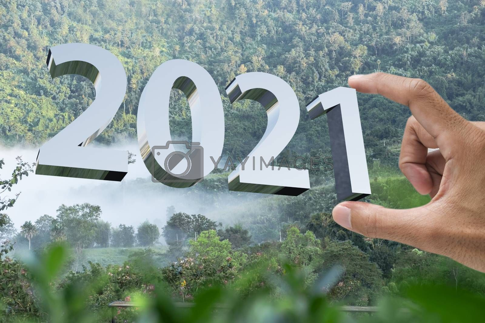 People man hand holding numbers 2021 Metaphor In the new year 2021 festival With scenic scenery In the forest Mountain and fog of Khao Kho Phetchabun Thailand Count down change 2020 to 2021 year