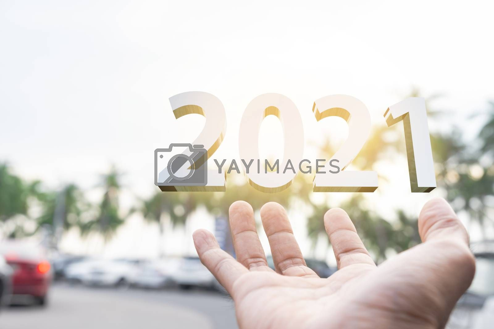 People man hand holding numbers 2021 Metaphor In the new year 2021 festival With scenic scenery In the forest Mountain and fog of Beangsan Thailand Count down change 2020 to 2021 year