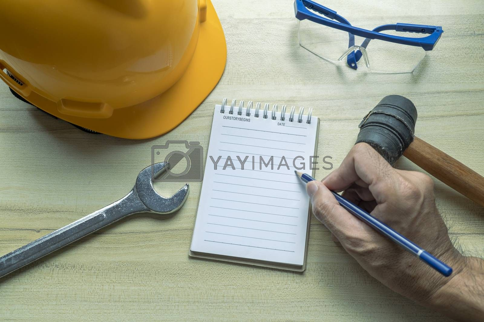 Hand people man with notepad For checking factory or industry on desk for note writing inspector.Metaphor Quality inspection or Production speed For the best quality to customers.