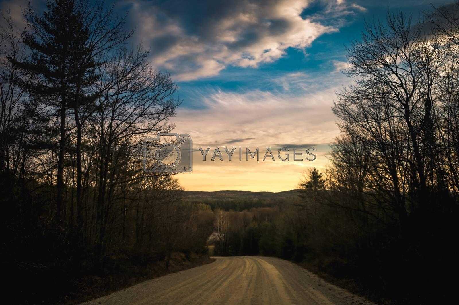 Sky at sunset from a dirt road at the top of a hill in rural highlands