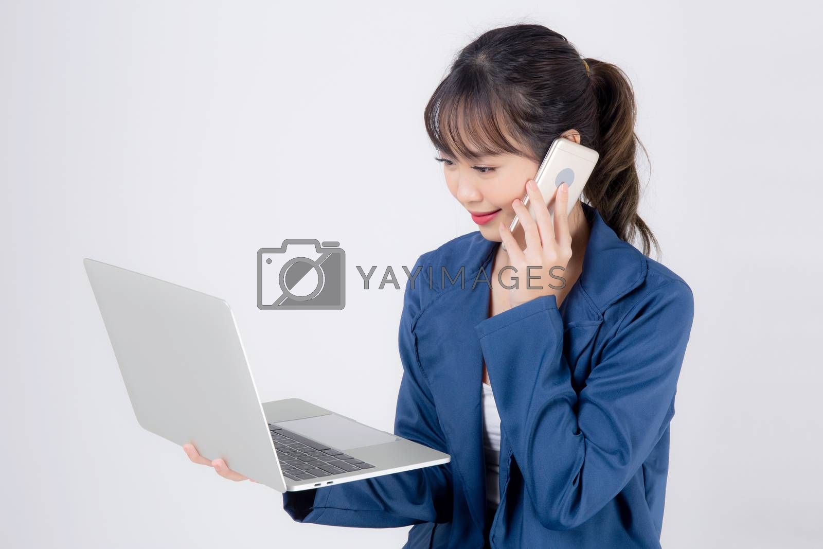 Beautiful portrait young asian business woman holding laptop computer and talking smart mobile phone isolated on white background, model businesswoman using notebook, communication concept.