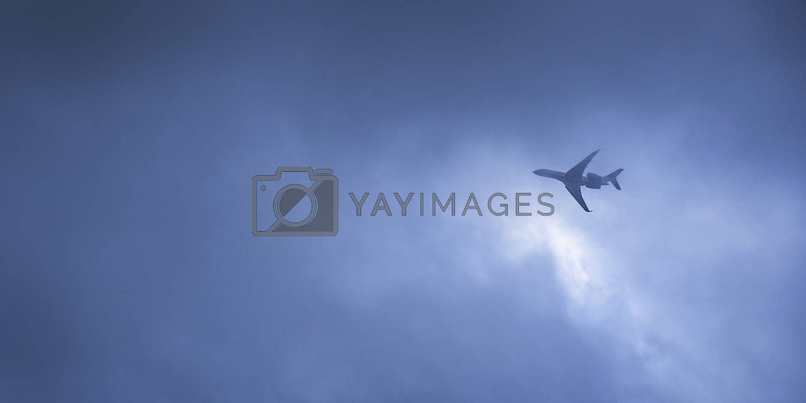 Airplane flying in the strom  by Surasak