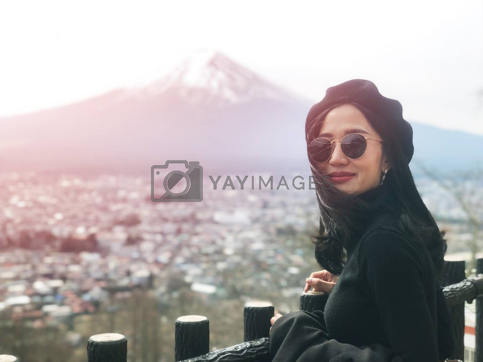 Beautiful smiling woman tourists are traveling and feel happy with Mt Fuji, Japan
