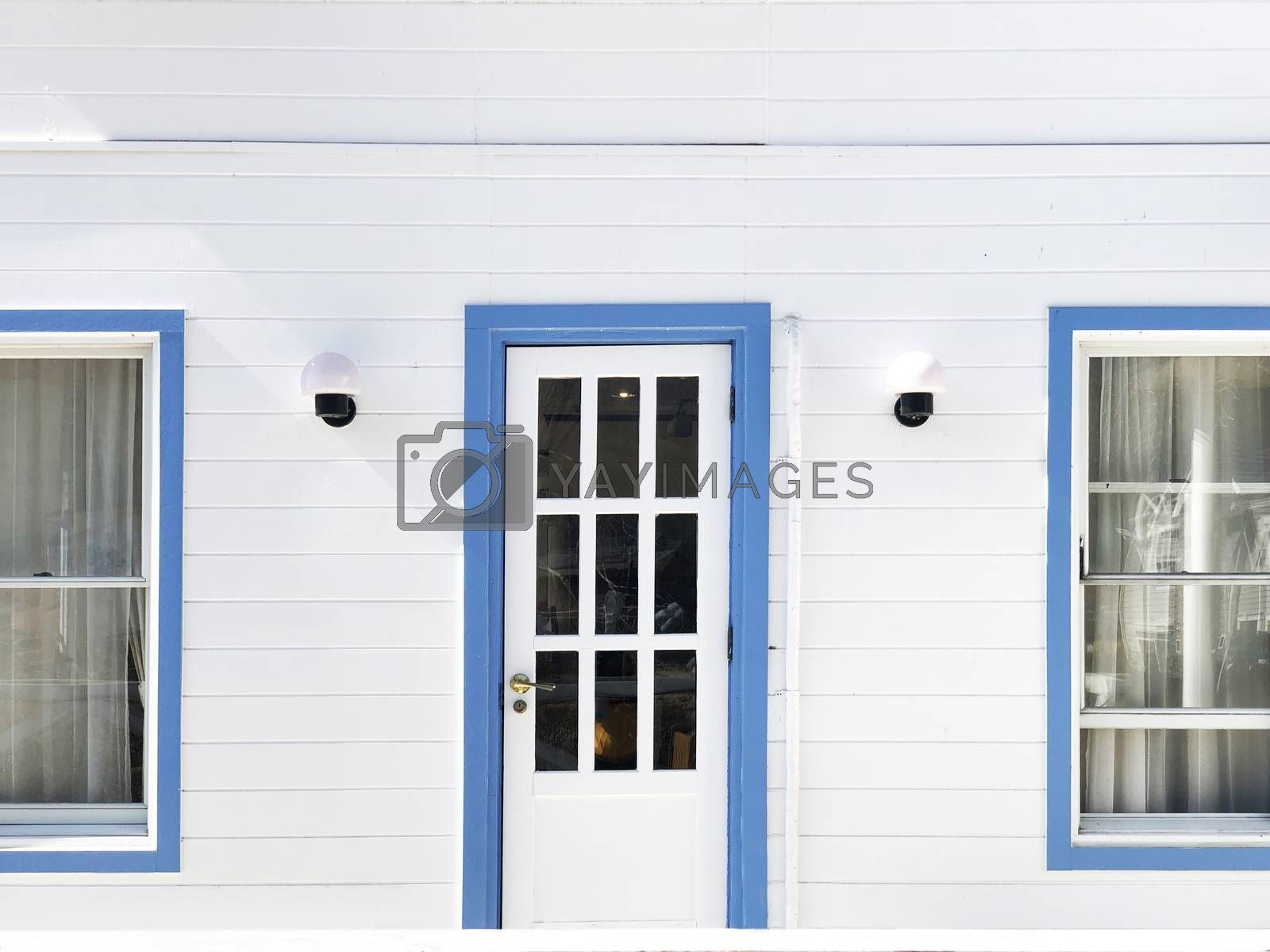 Vintage blue door with white house