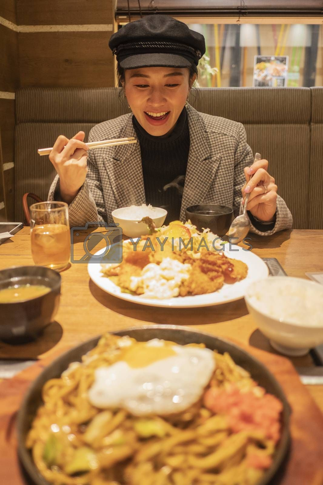 Beautiful asian woman enjoy eating Japanese food in restaurant
