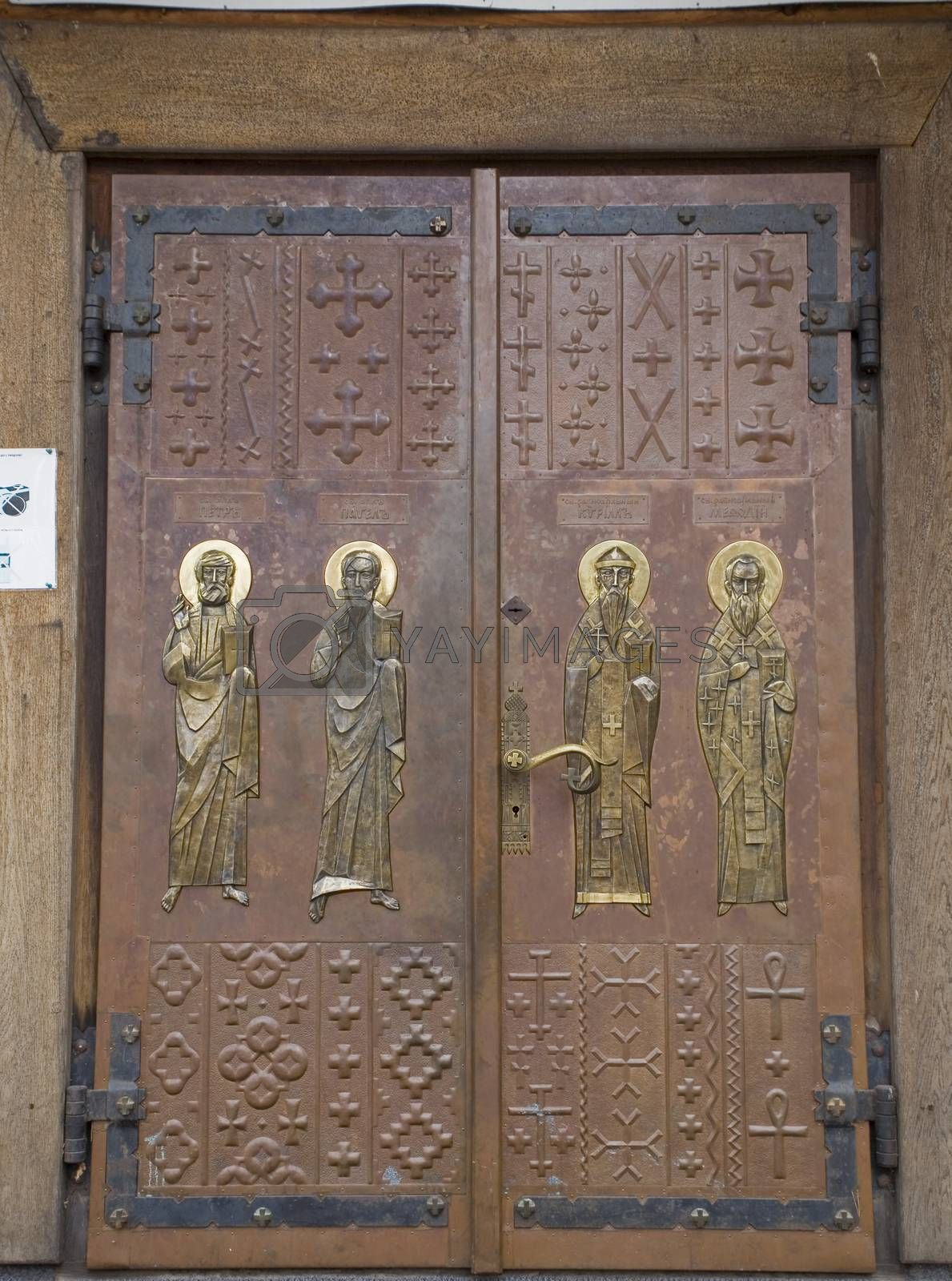 Royalty free image of  large wooden door with Orthodox religious symbols by Lukrecja
