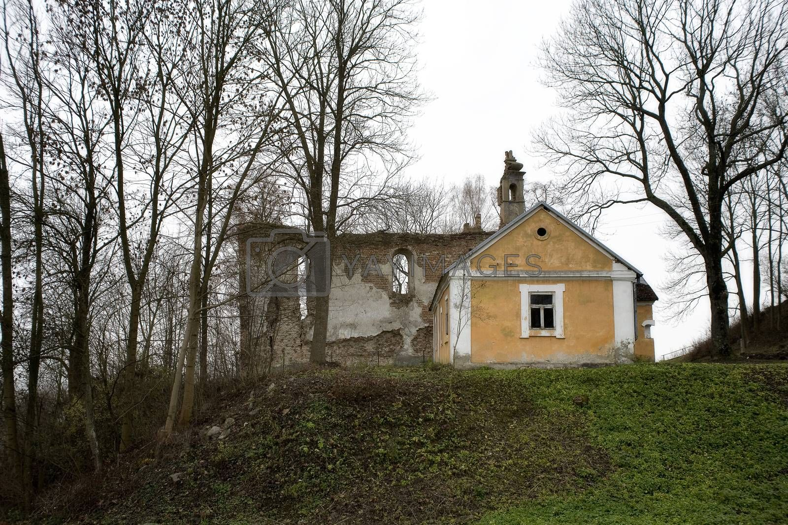 Royalty free image of old historic house with wall ruins on gray november day in Podla by Lukrecja