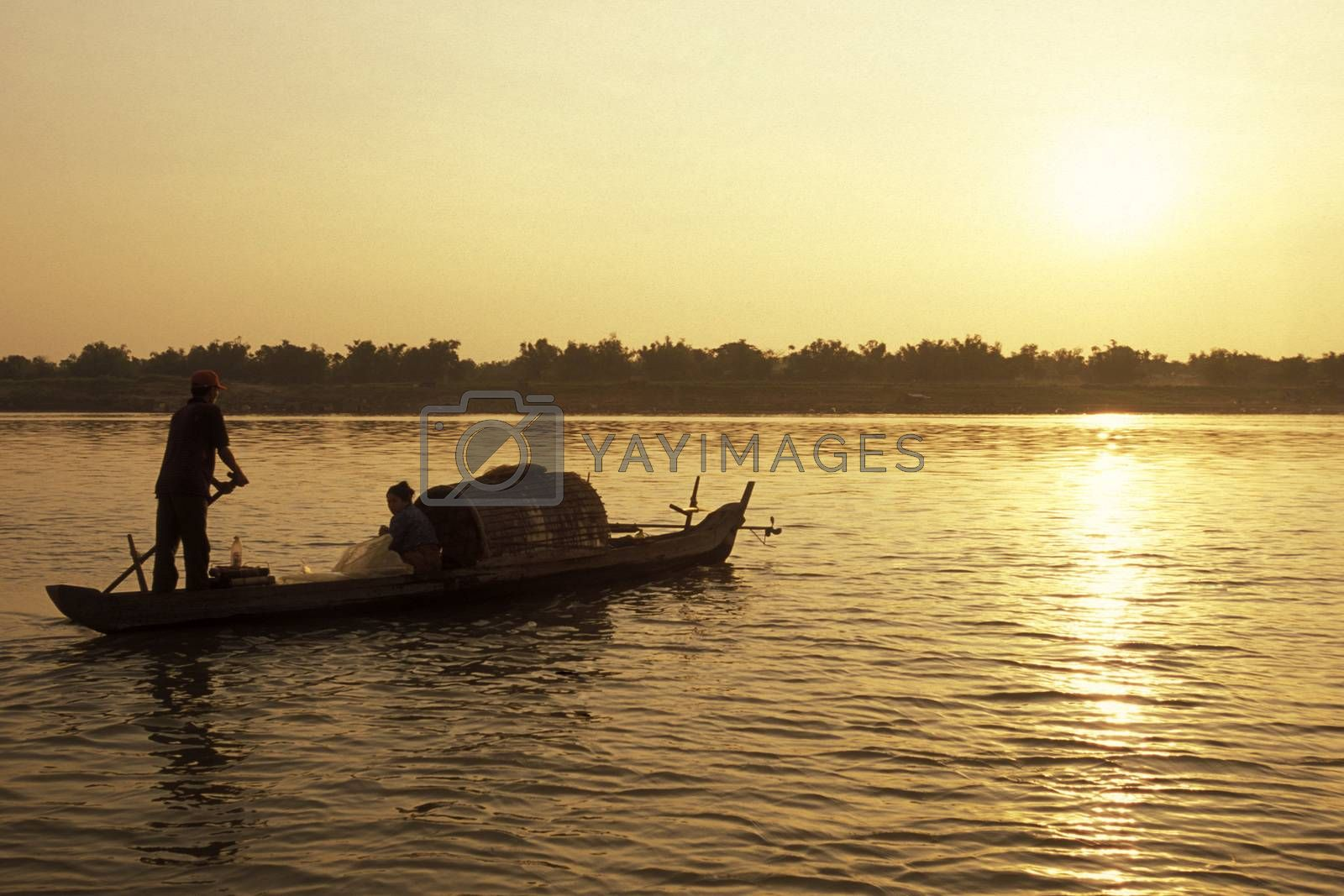 a fishing boat on the Mekong river at the village of Kampong Cham in the centre of Cambodia.  Cambodia, Kampong Cham, February, 2001,