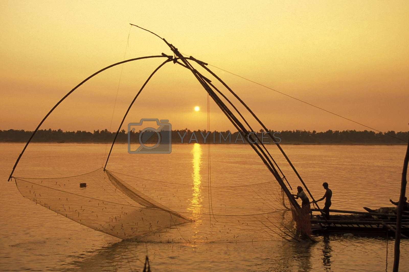 a fishing net on the Mekong river at the village of Kampong Cham in the centre of Cambodia.  Cambodia, Kampong Cham, February, 2001,