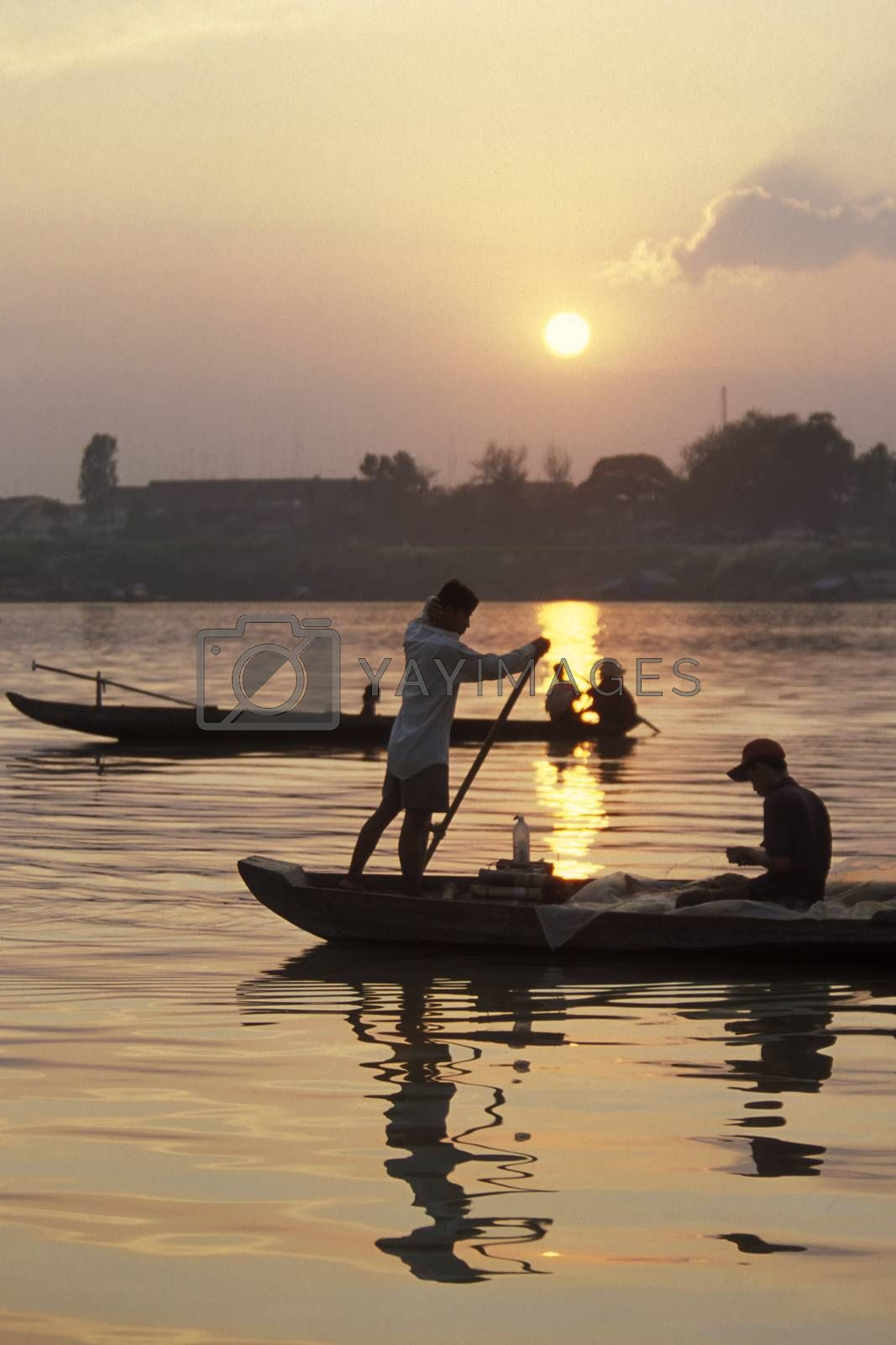 a fishing oat on the Mekong river at the village of Kampong Cham in the centre of Cambodia.  Cambodia, Kampong Cham, February, 2001,
