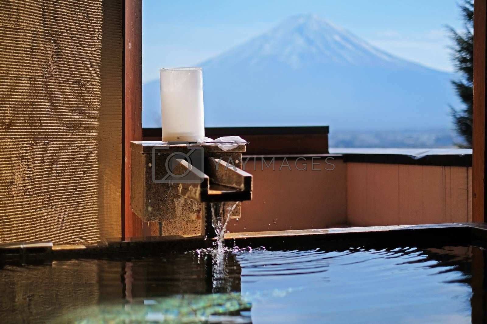 Outdoor hot-spring bath with the beautiful view of Mountain Fuji and Lake Kawaguchiko in Japan