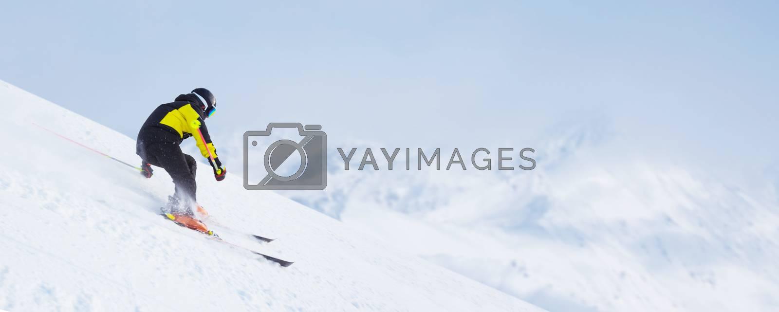 Skier man skiing downhill in high mountains piste, Solden, Tyrol, Austria