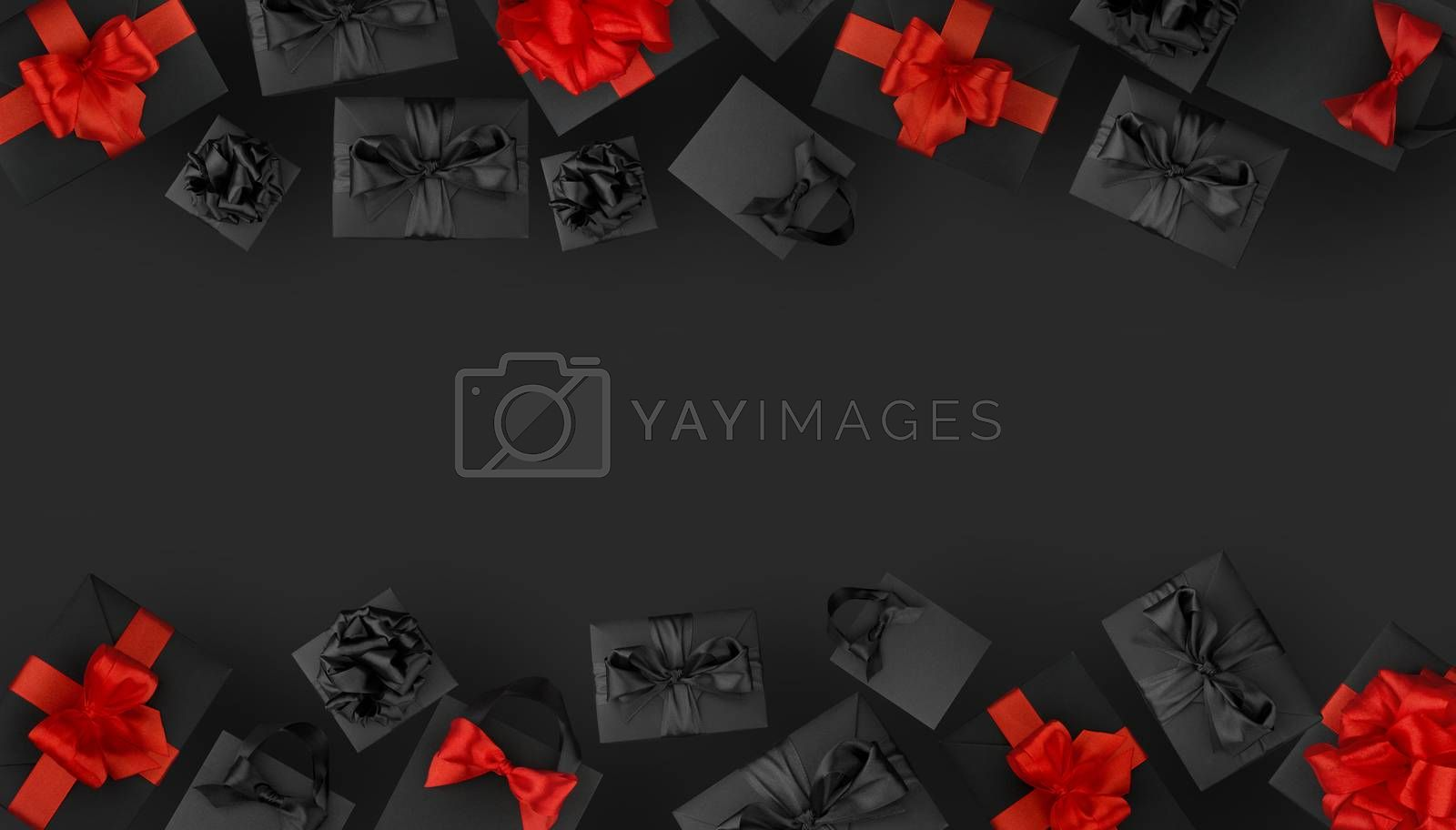 Black shopping bags and gift boxes and red bows on black background with copy space for text, Black Friday sale shopping concept