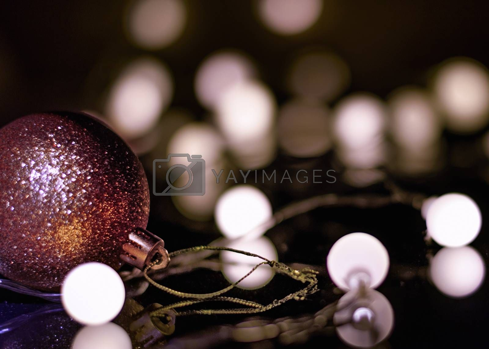 Royalty free image of Christmas toy and garland by VladimirZubkov