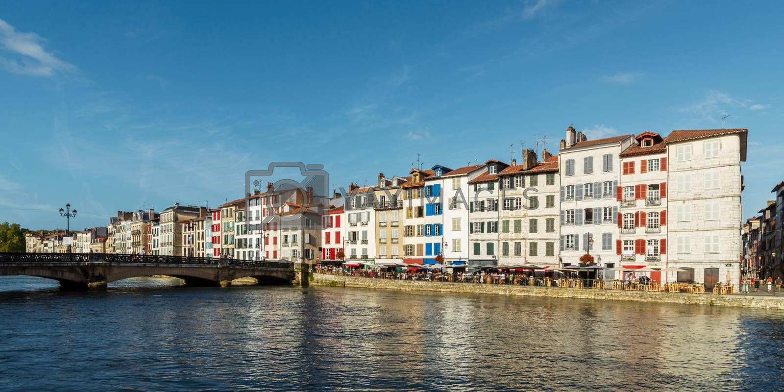 Colorful building facades along the Nive river, in Bayonne, France