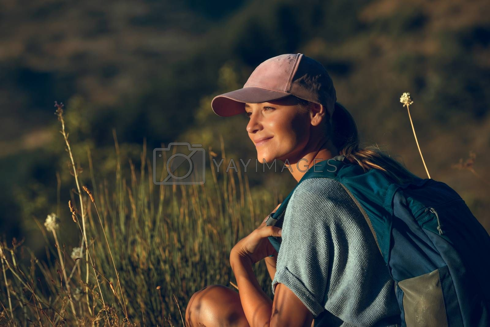 Portrait of a Beautiful Happy Woman Enjoying Mild Sunset Light in the Mountains. Beauty of Wild Nature. Peaceful Quiet Weekend Outdoors.