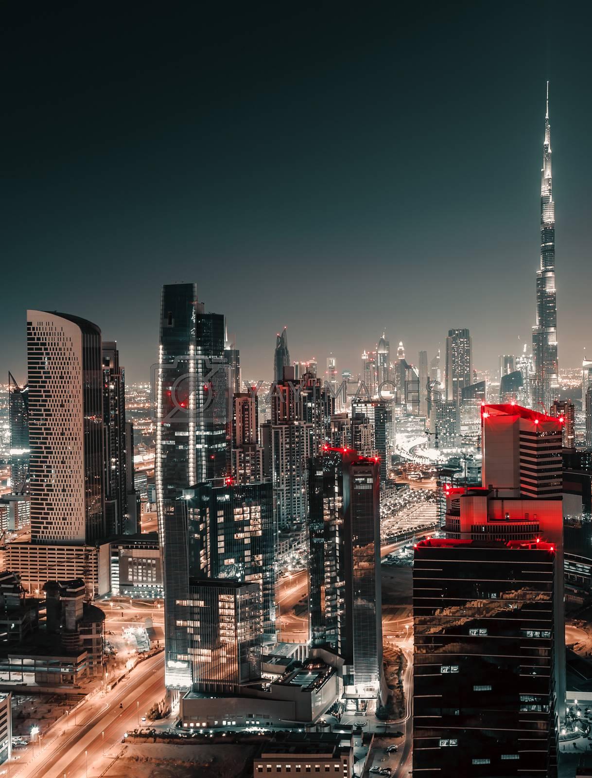 Nighttime Cityscape. Urban Scene Background of a Modern Towers at Night. Lights of Big City. Dubai. United Arab Emirates.