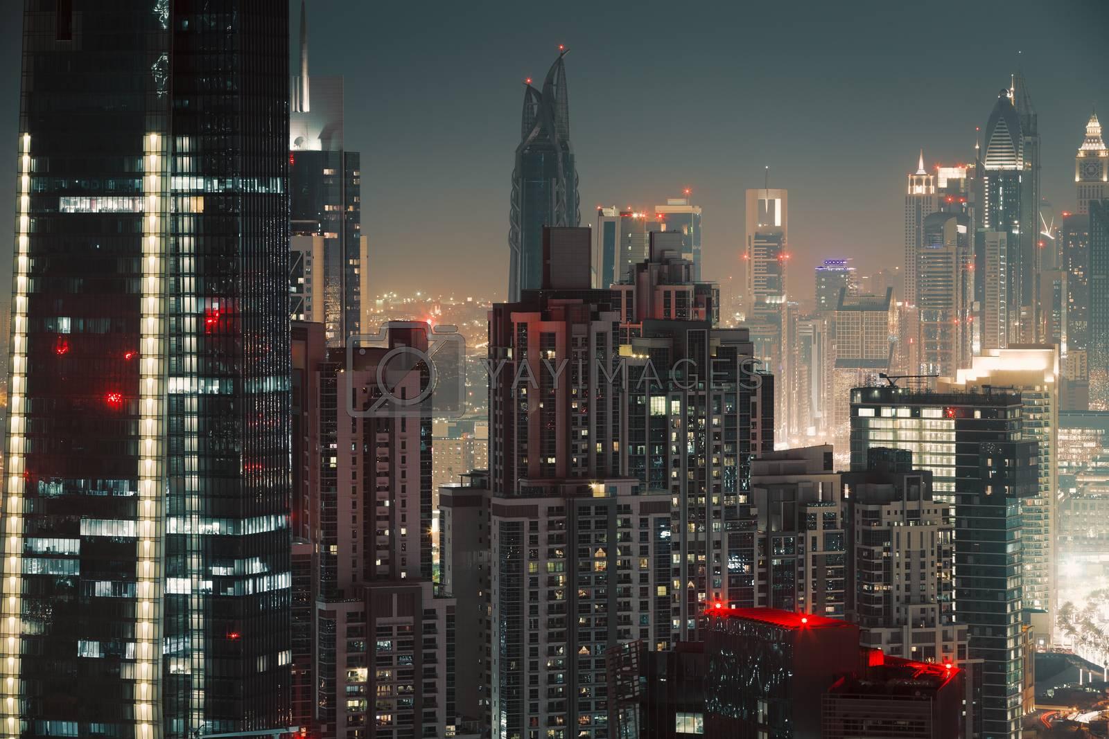 Beautiful Dubai Night Scene Background. Lights of Skyscrapers at Nighttime. Luxury Property. Middle East Travel Destination. United Arab Emirate