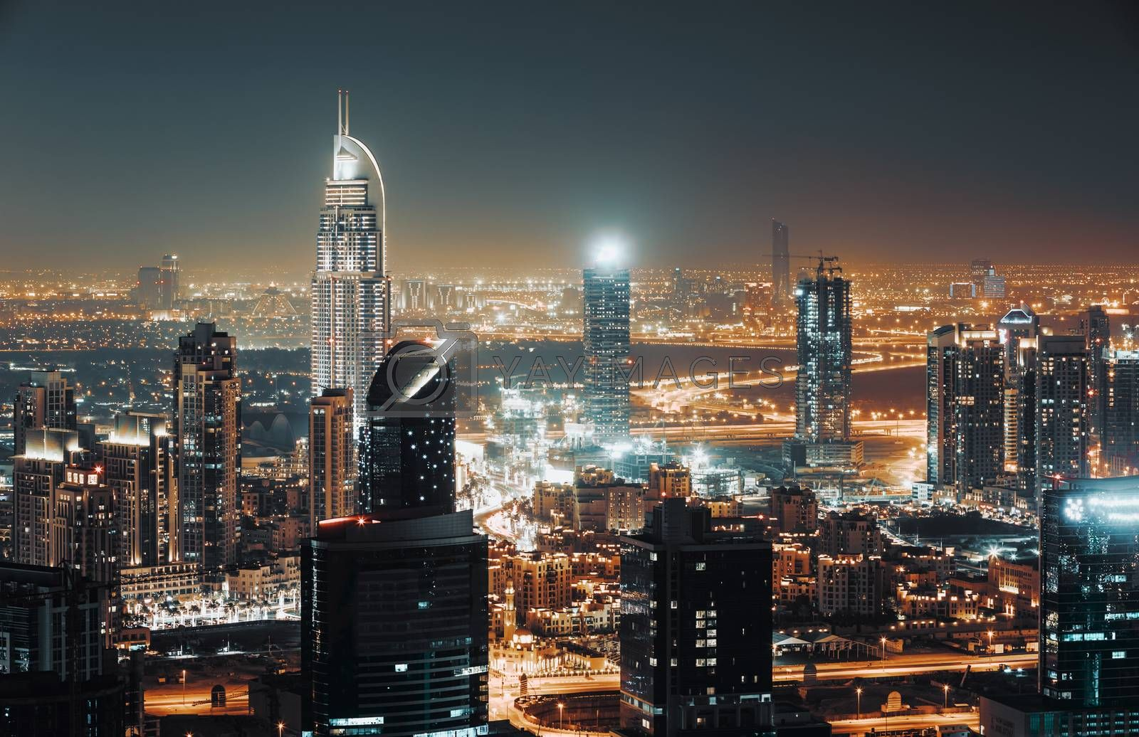 Beautiful Cityscape of a Modern Futuristic Buildings and Towers in the Lights of a Night City. Beauty of Luxury Life of Emirates. Dubai. United Arab Emirates.