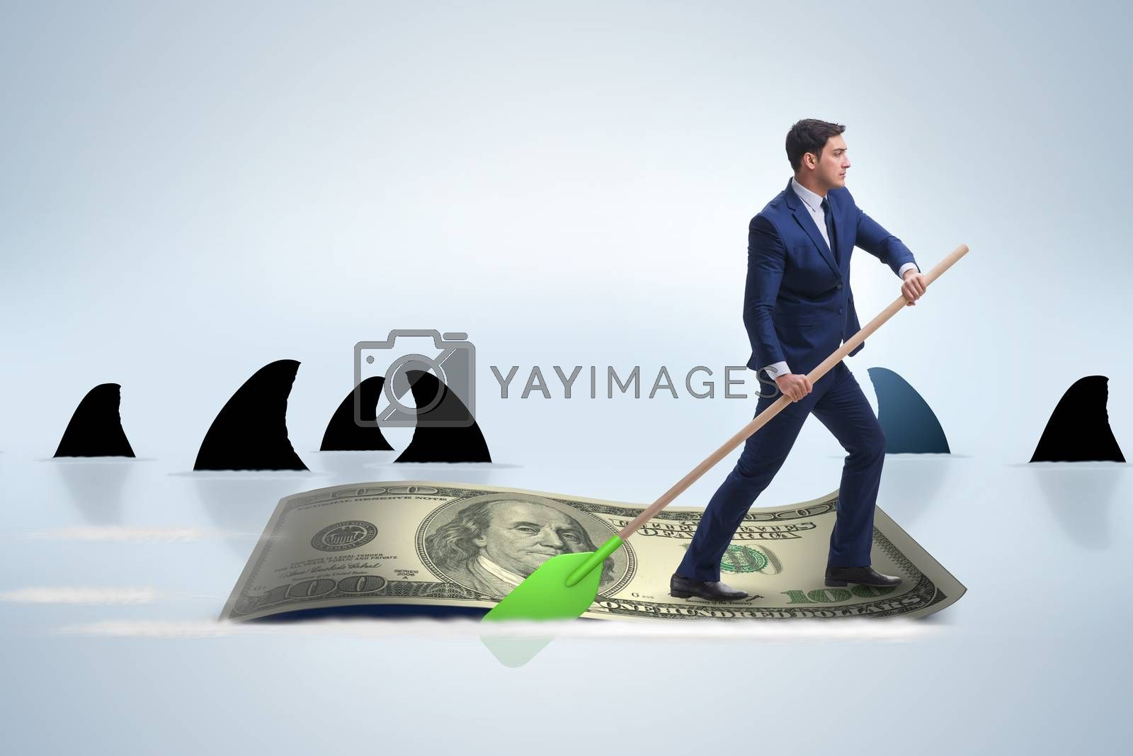 Businessman rowing on dollar boat in business financial concept