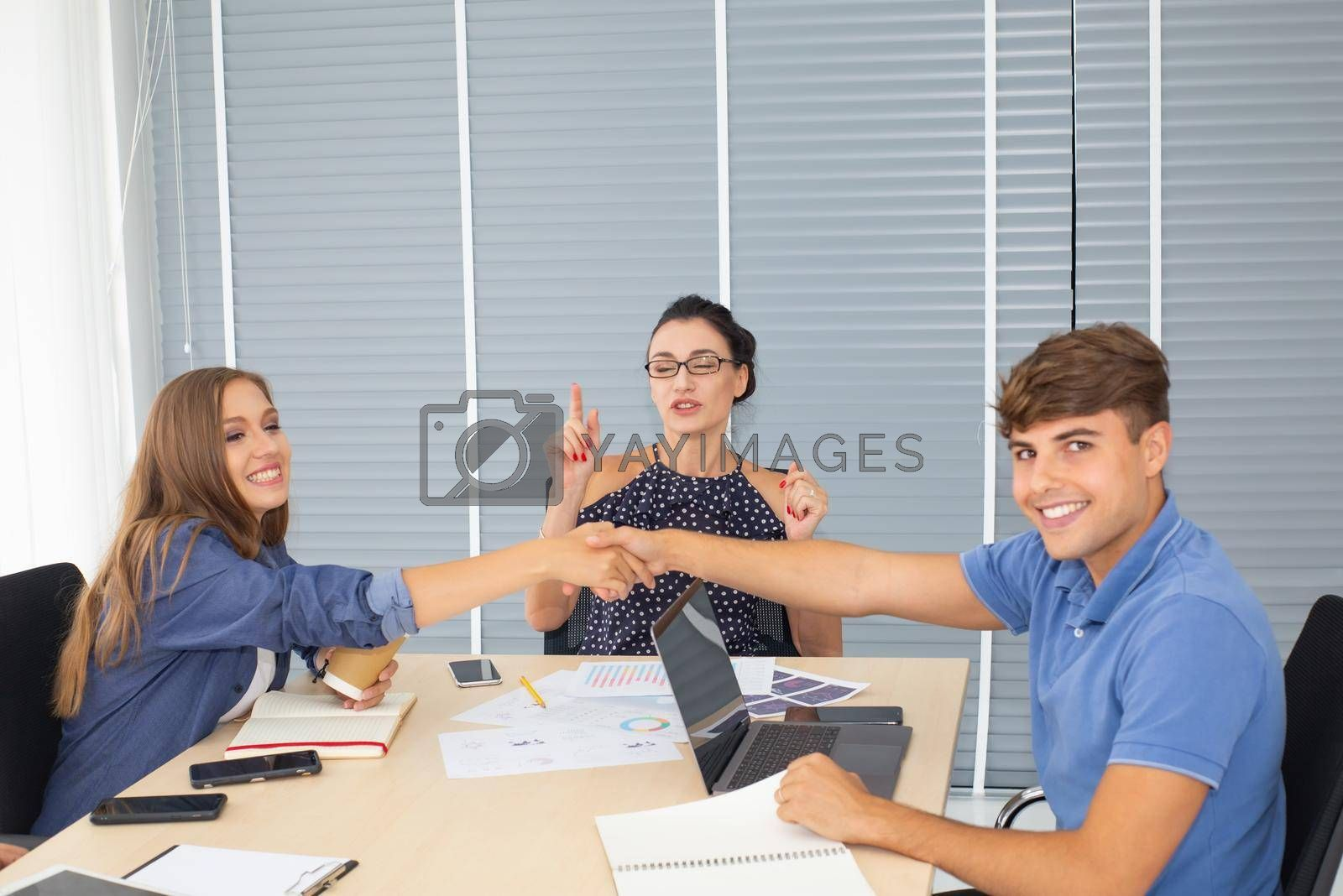 Business people working in office on desktop computer, Group of happy business people in smart casual wear looking at the laptop and gesturing. Achieving success.