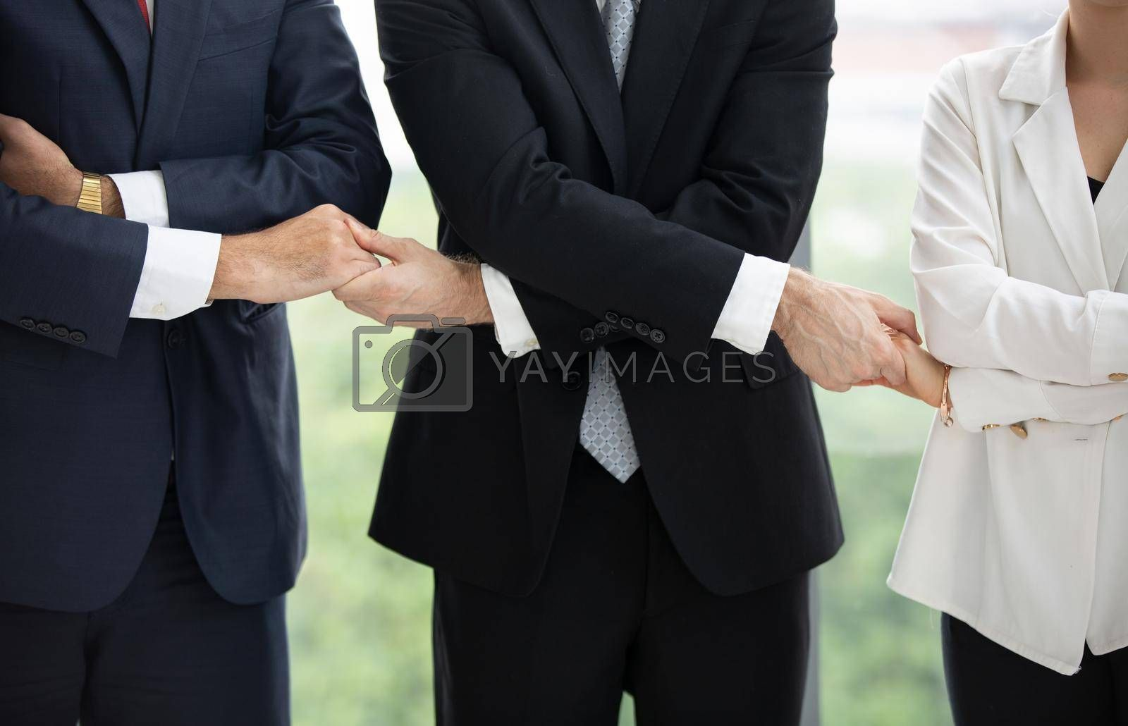 Business people give hands stack or holding each other for Unity and teamwork concept.