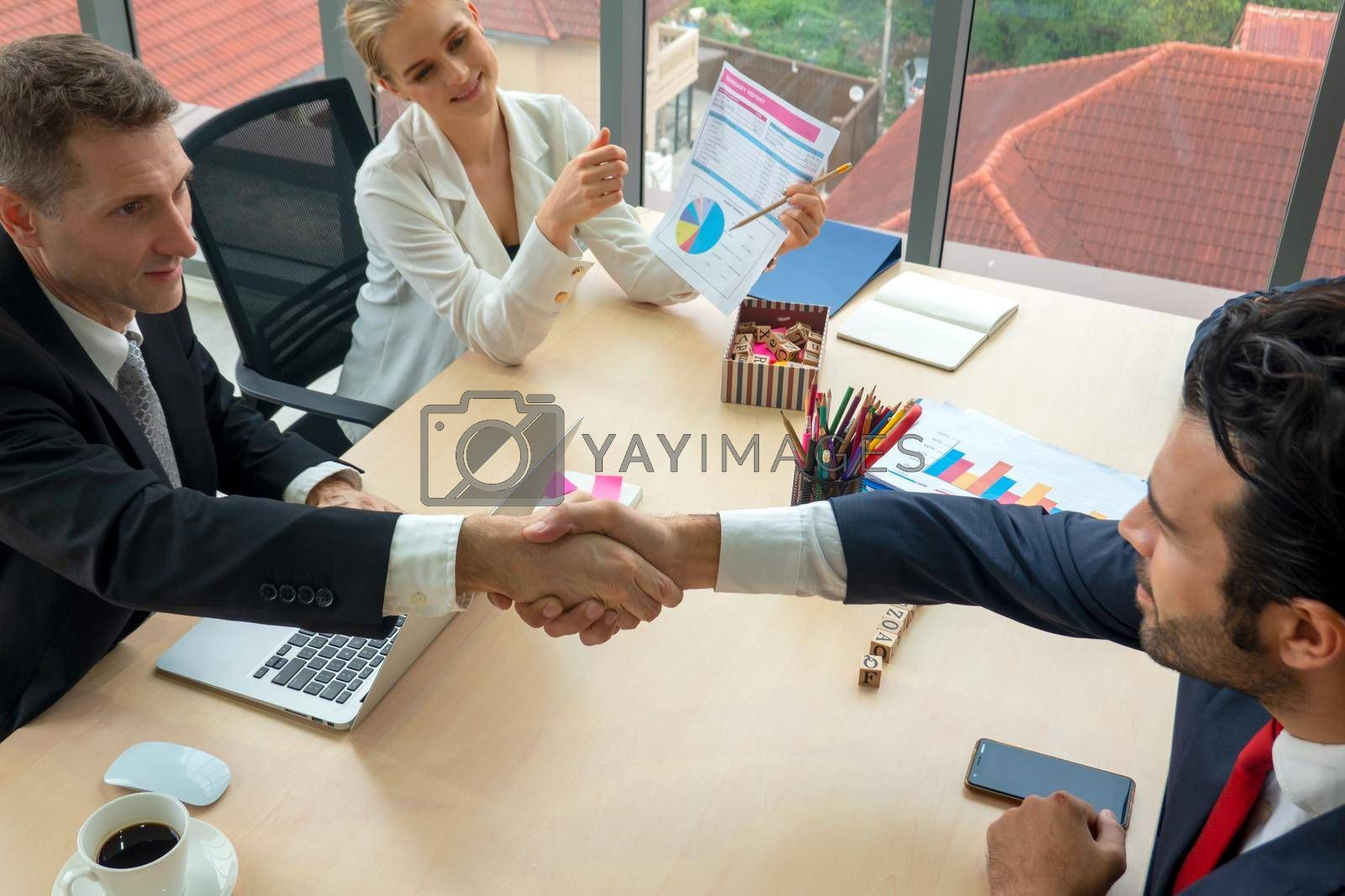 Business people shaking hands in the modern office finishing successful meeting