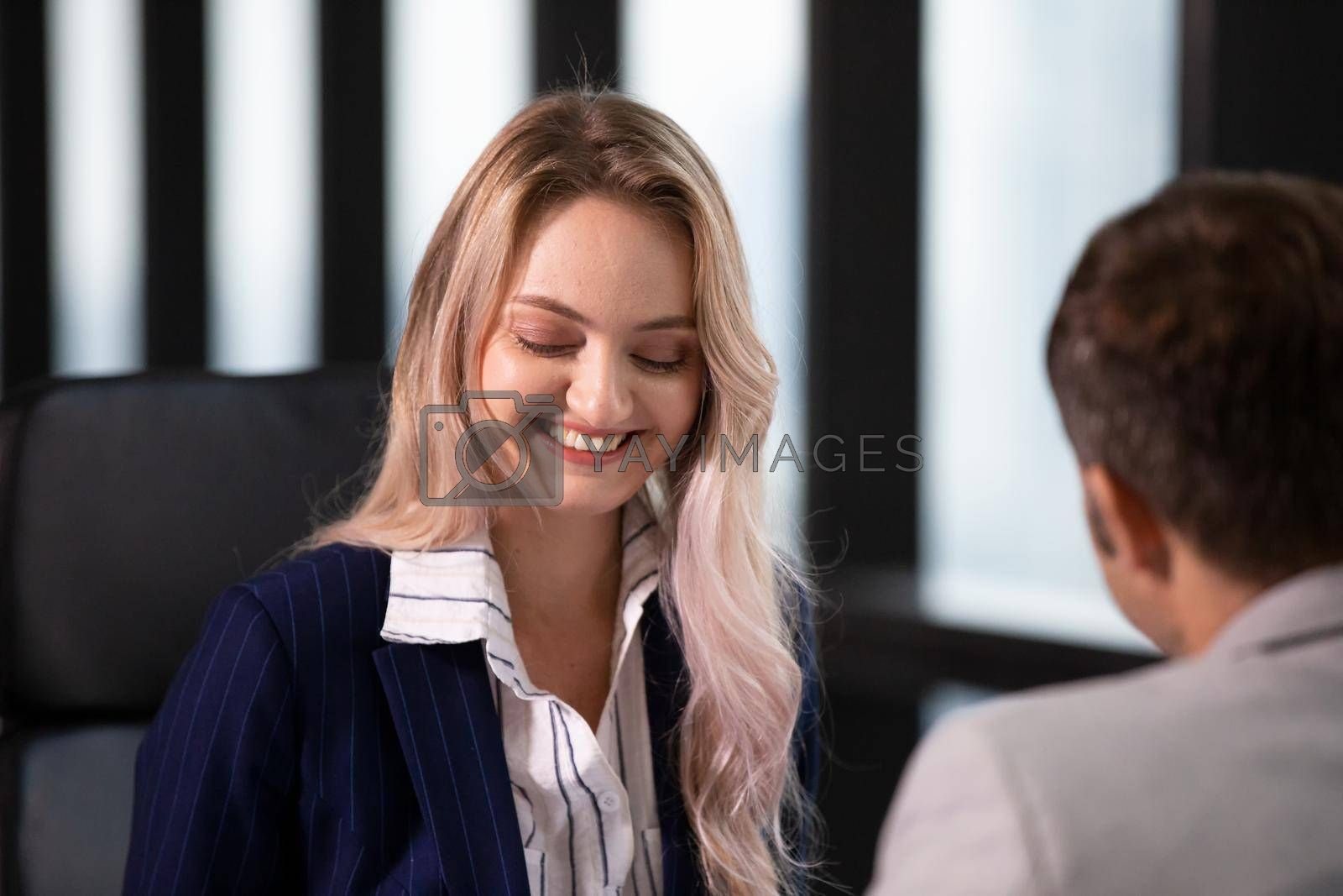 Business women discussing coworker