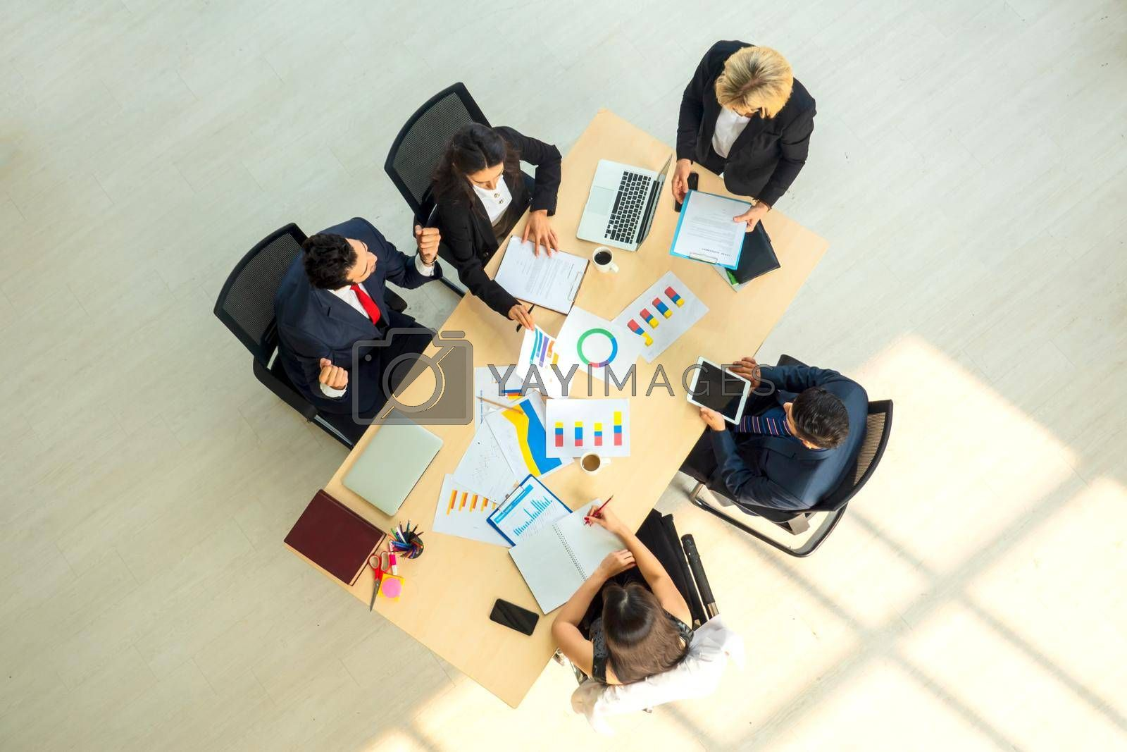 Top view on a group of businessman and businesswoman having a meeting and making a business commitment.