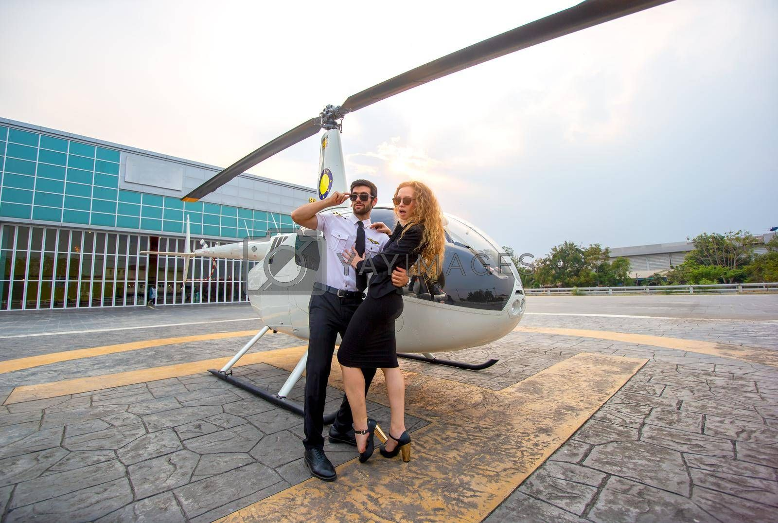 Business people traveling by helicopter , Shot of a mature businessman using a headset while traveling in a helicopter