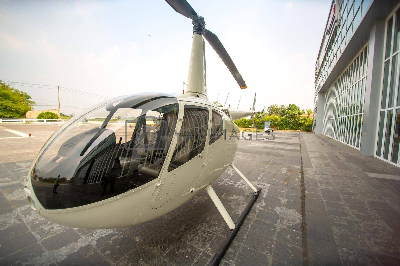 private commercial Helicopter parking by airport terminal