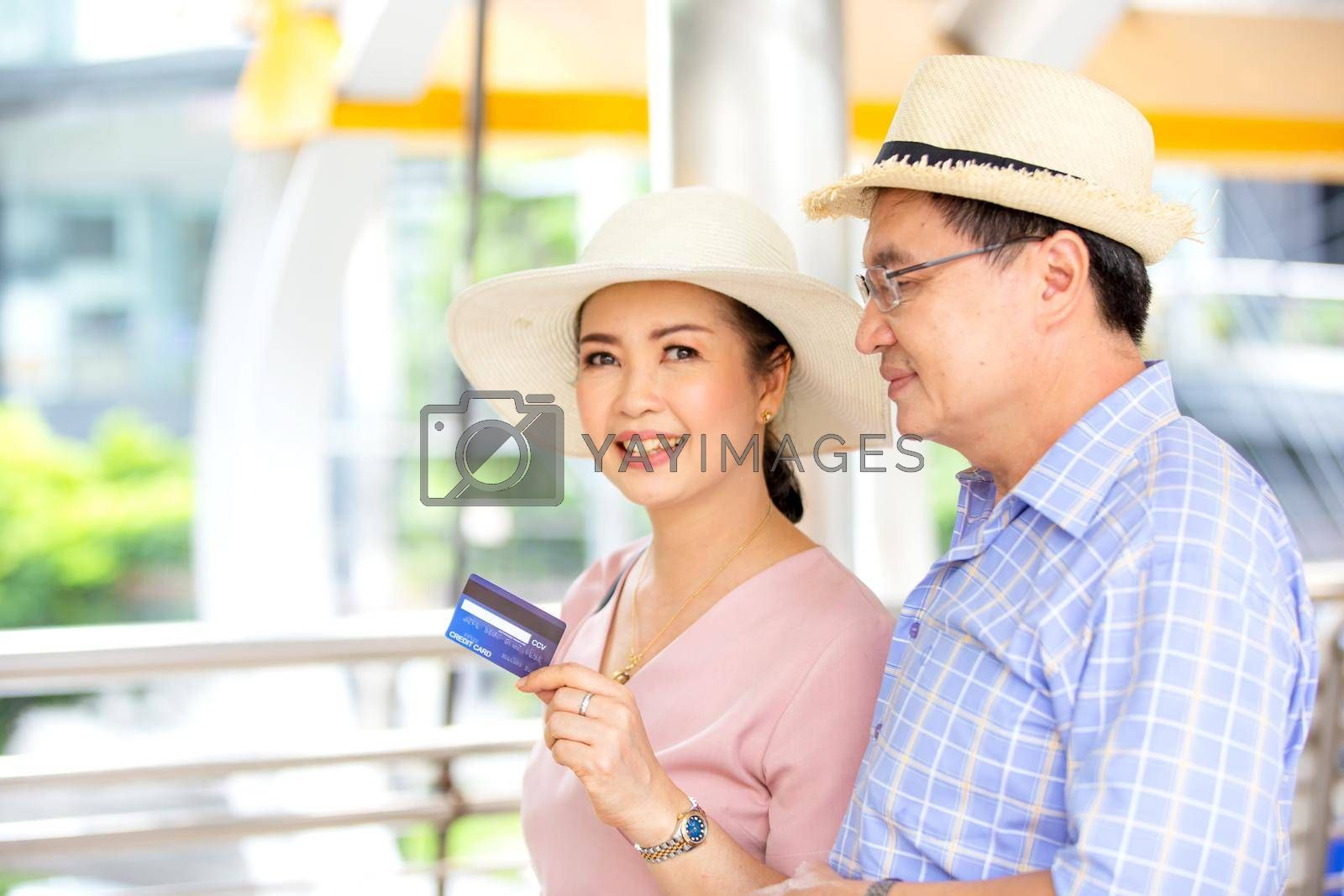 Asian couple enjoy travelling and walking on the street in city.