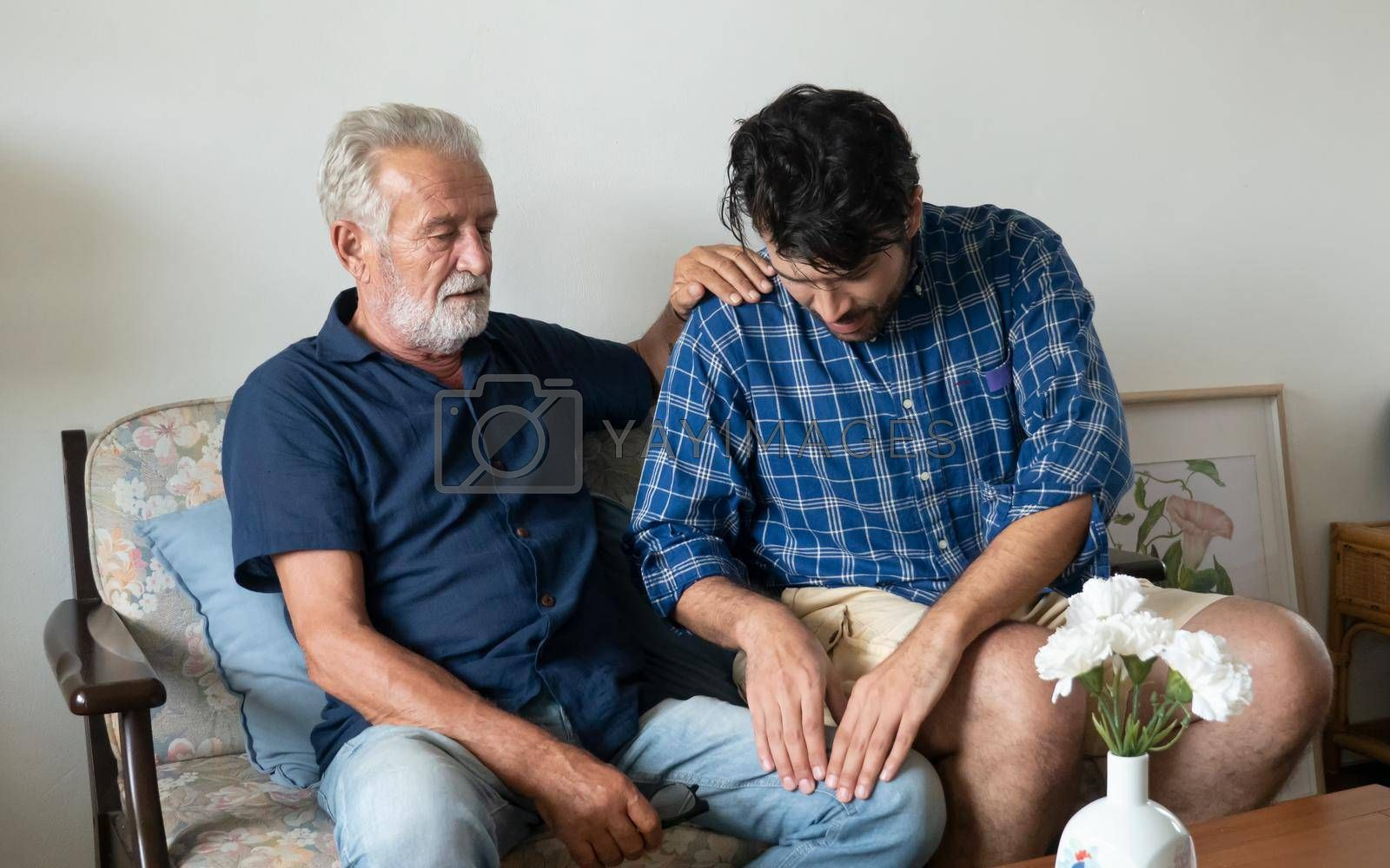 Hipster man taking care about his elderly father in house.