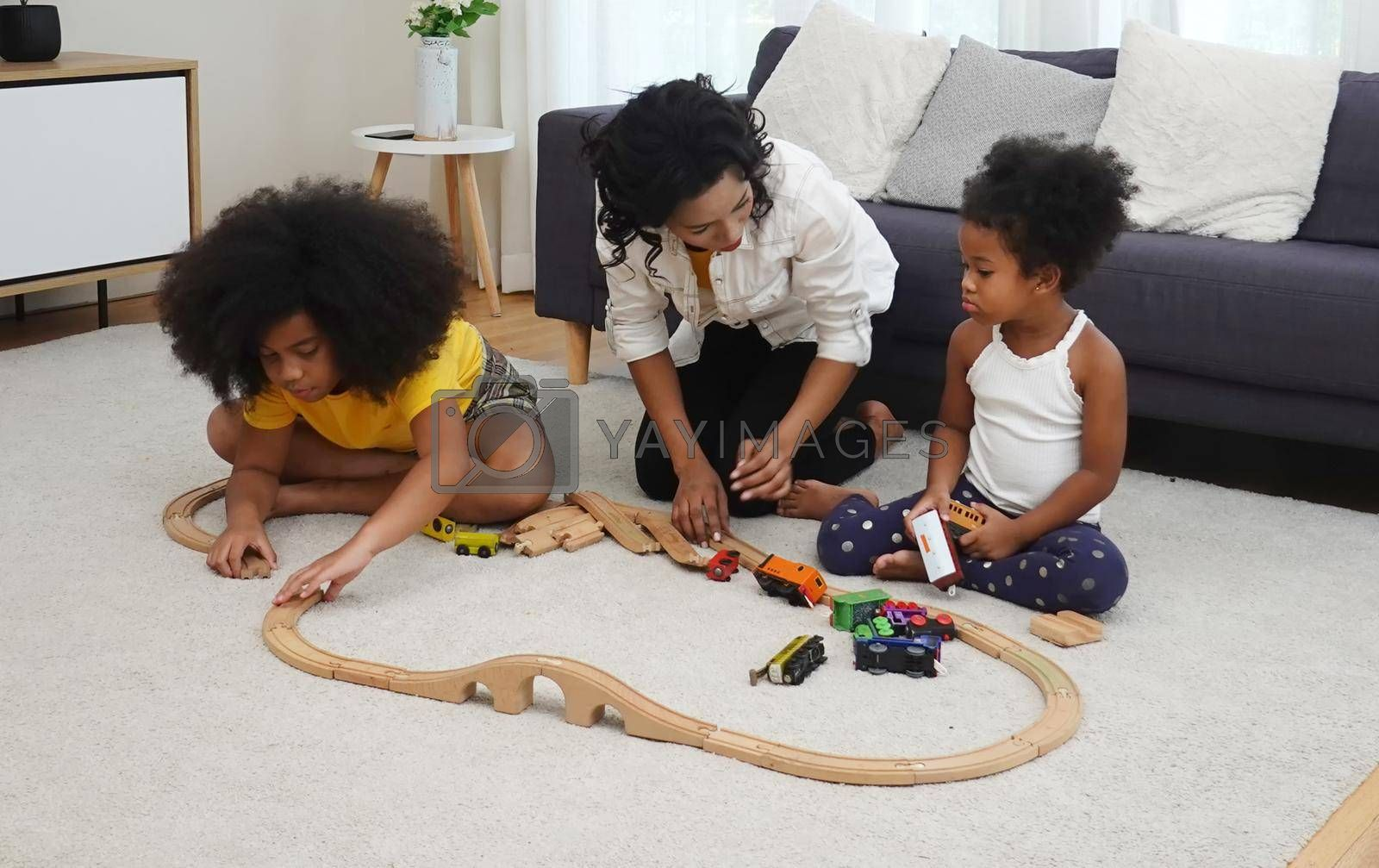 Mix race of family, dad, mom and daughters play together in living room