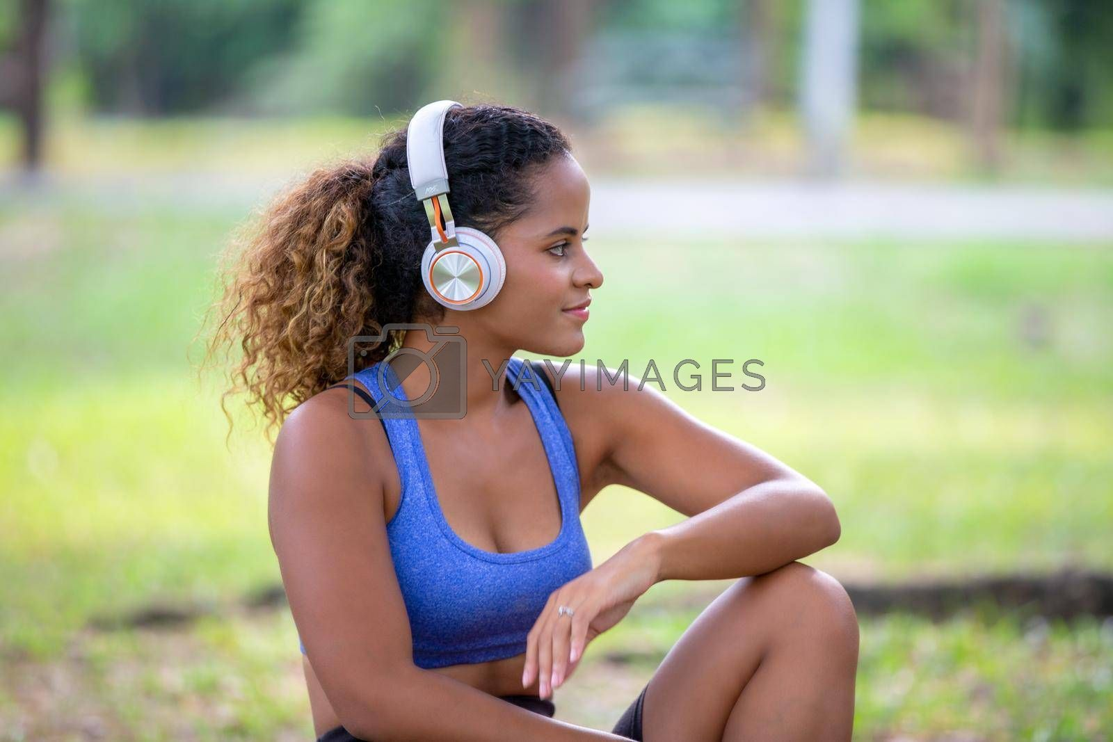 Young attractive smiling woman practicing yoga pose, working out, wearing sportswear pants, bra, full length, outdoor.
