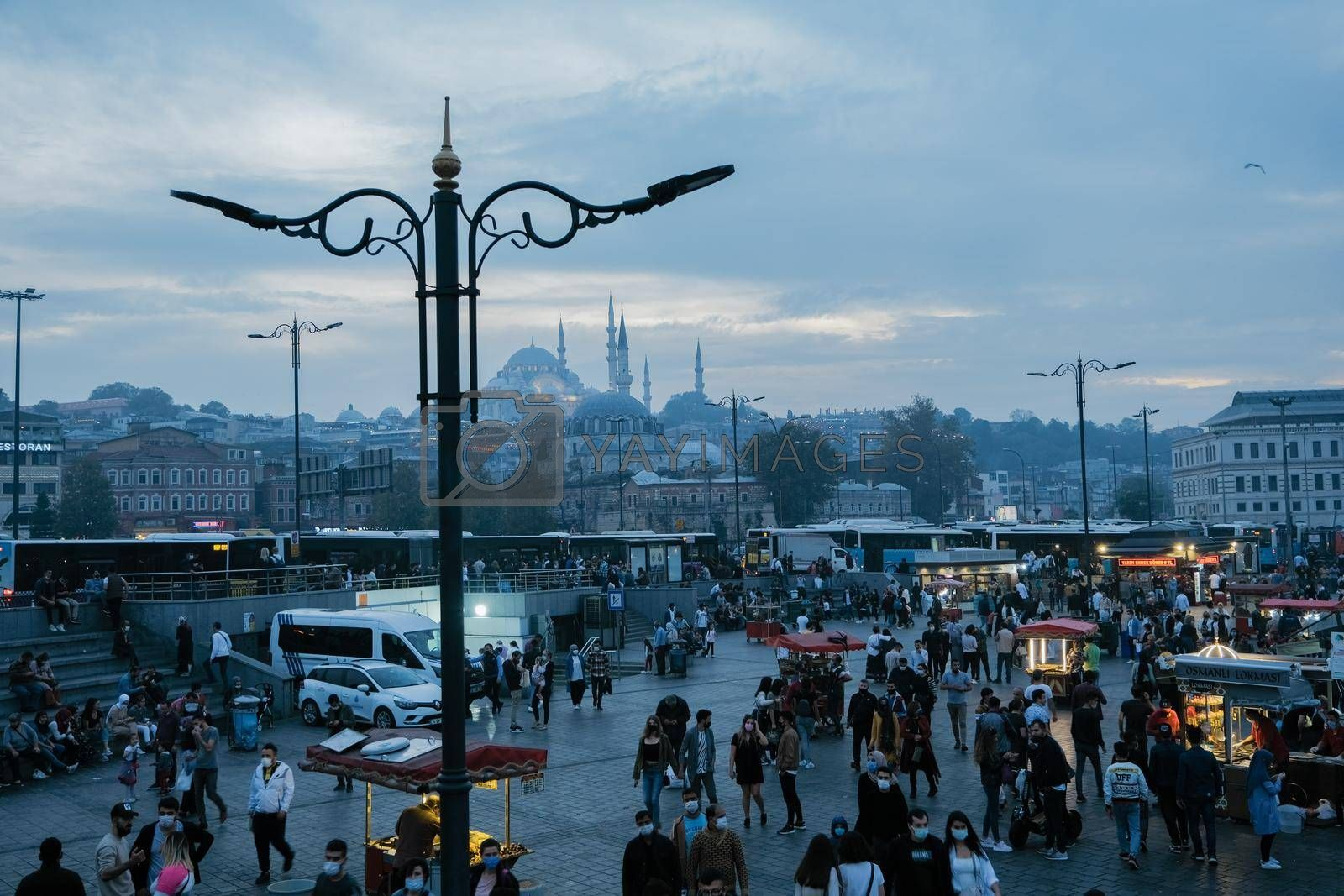 Eminonu, Istanbul, Turkey - November 05, 2020. The picture was taken in Eminonu district on Galata bridge in the afternoon and depicts the crowd and mosques around.