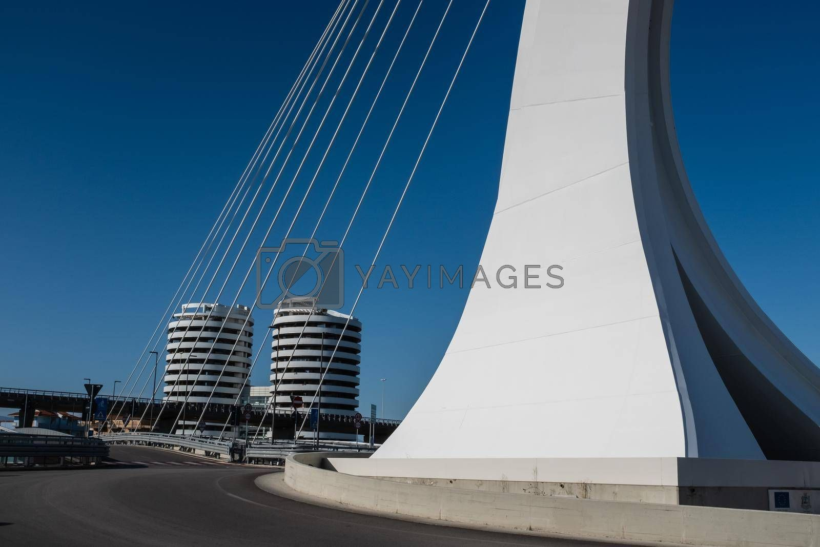 Street level view of Ennio Flaiano Bridge, a cable-stayed bridge with a single pylon located in the center of the traffic circle on the north side of the Pescara river