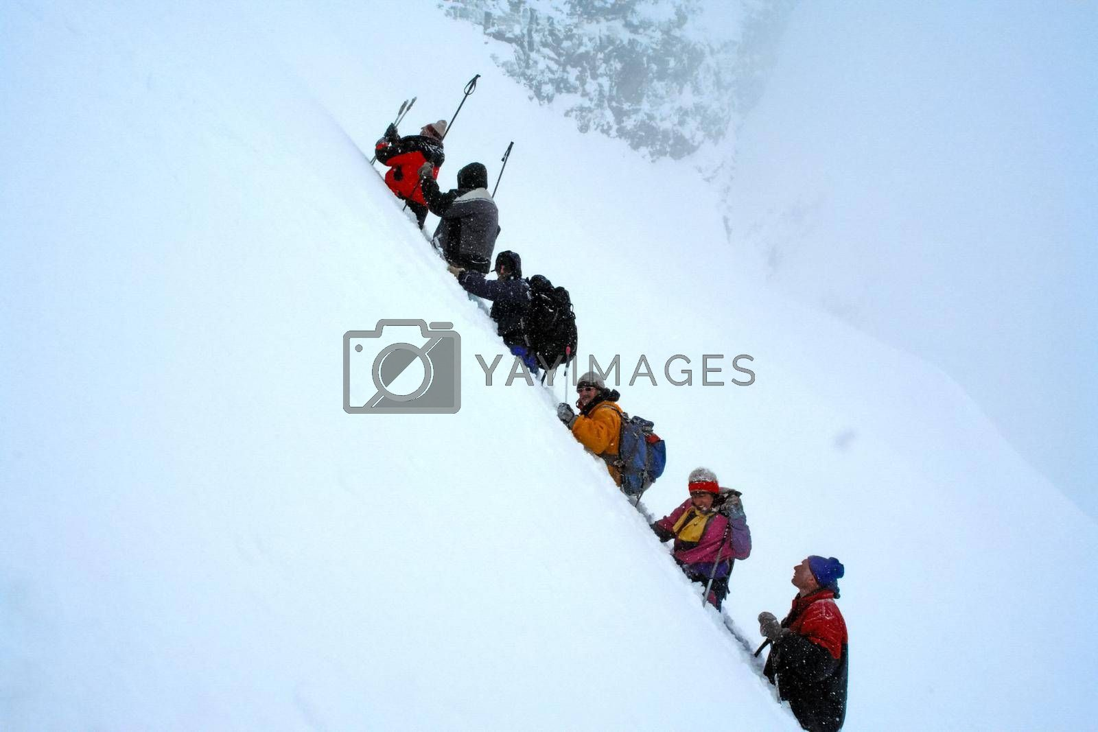 Tankhoy, Russia - January 20, 2019: A company of skiers in the mountains in the snow. Skiing.