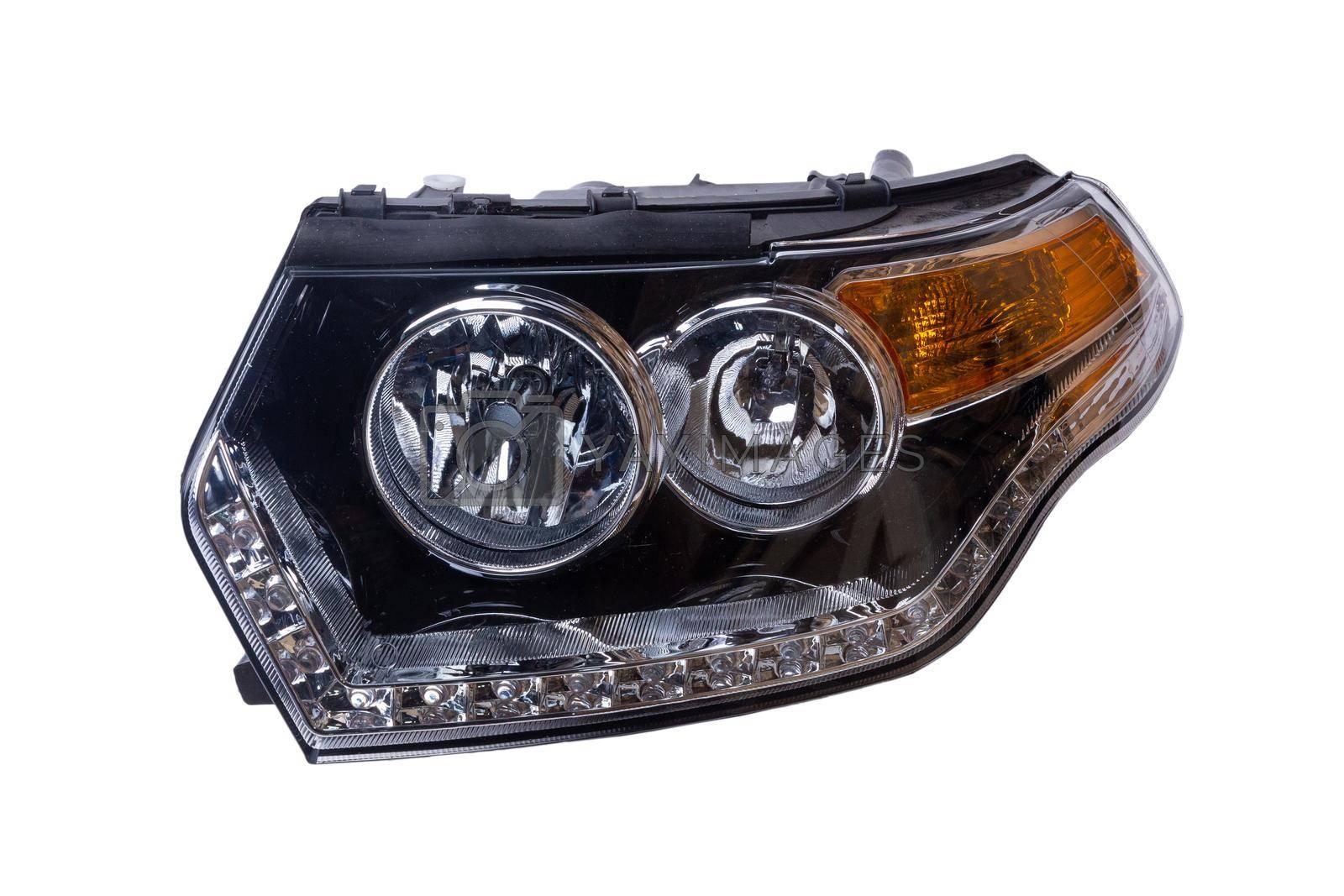 Car headlight isolated on white background.