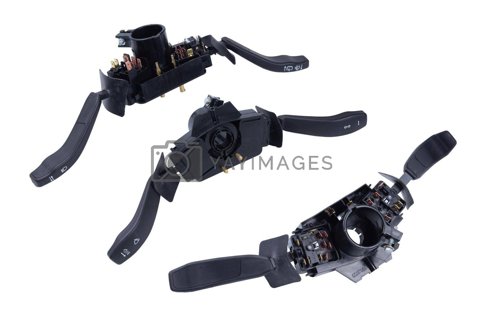 Steering wheel switches for windshield wipers and turn signals disassembled on a white isolated background in a photographic. by forester
