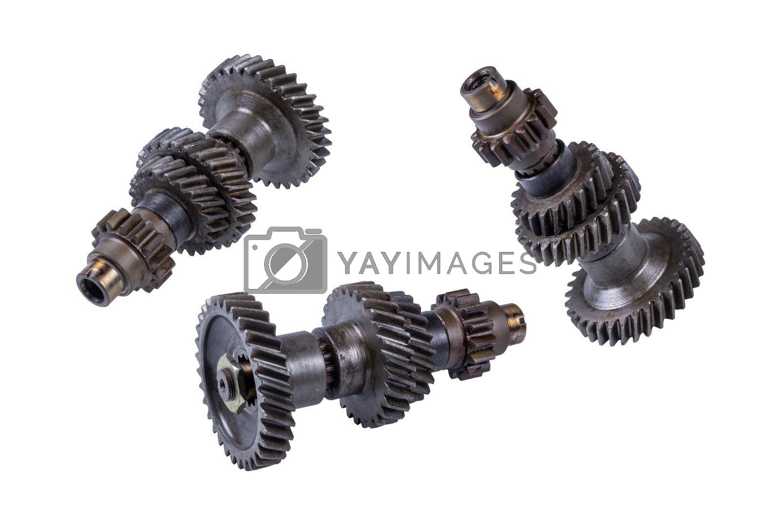 set of old gearbox gears, isolated on a white background. spare parts by forester
