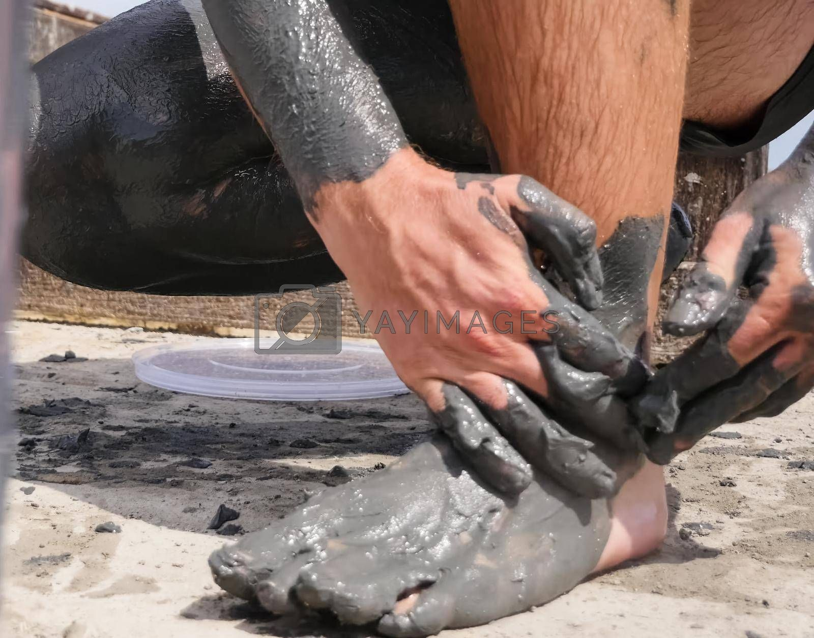 People are wiped with mud. Mud baths in Spain.