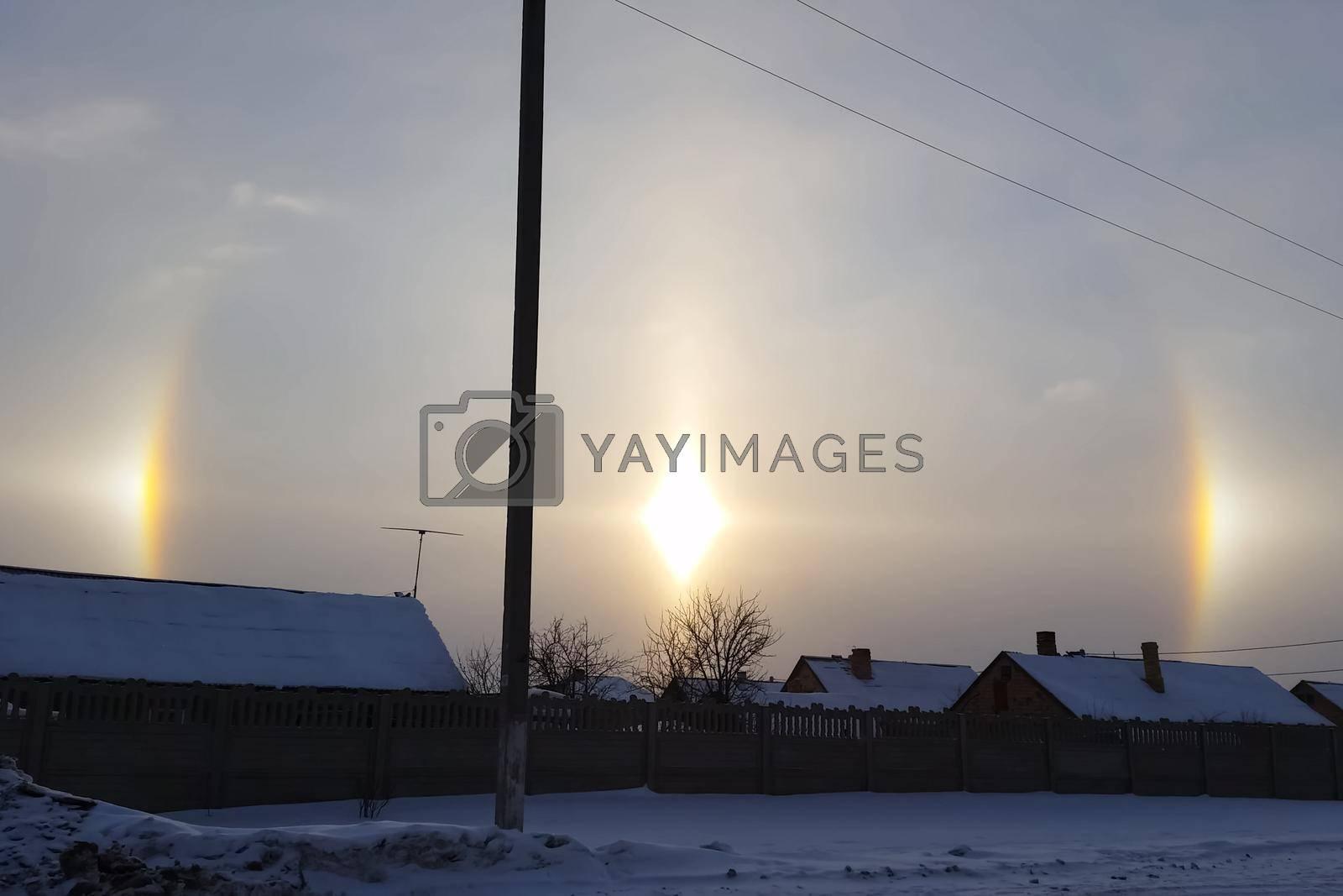 The phenomenon of halo in the sky. A rare natural phenomenon. Three halo suns.