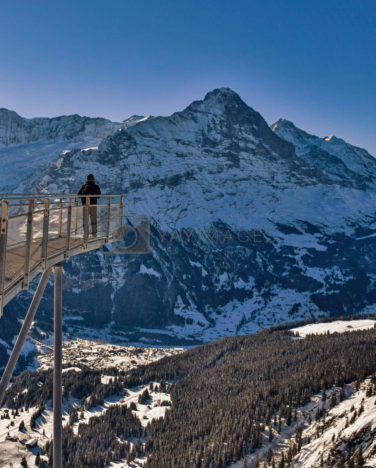 an observation deck named First Cliff Walk on top of First above Grindelwald, Bernese Oberland, Switzerland, Beautiful winter view of the North wall of the Eiger summit