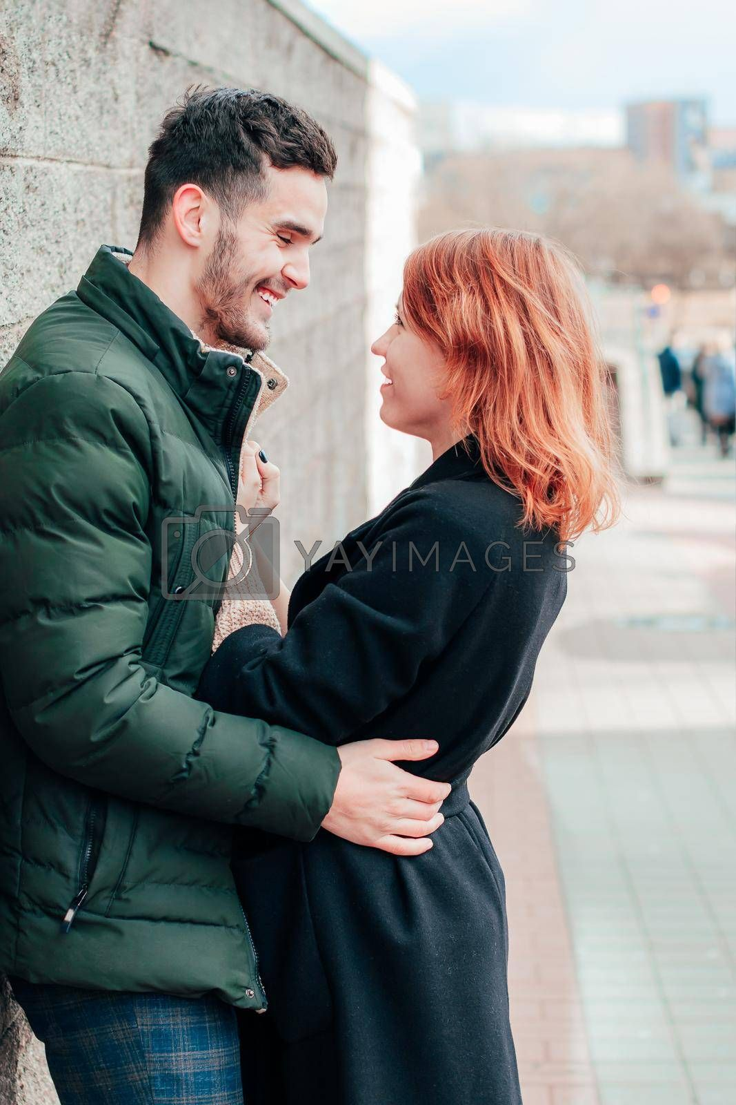 Happy Loving Couple Smiling and Hugging on the Street. Two Happy People Love Story - Medium Shot Portrait