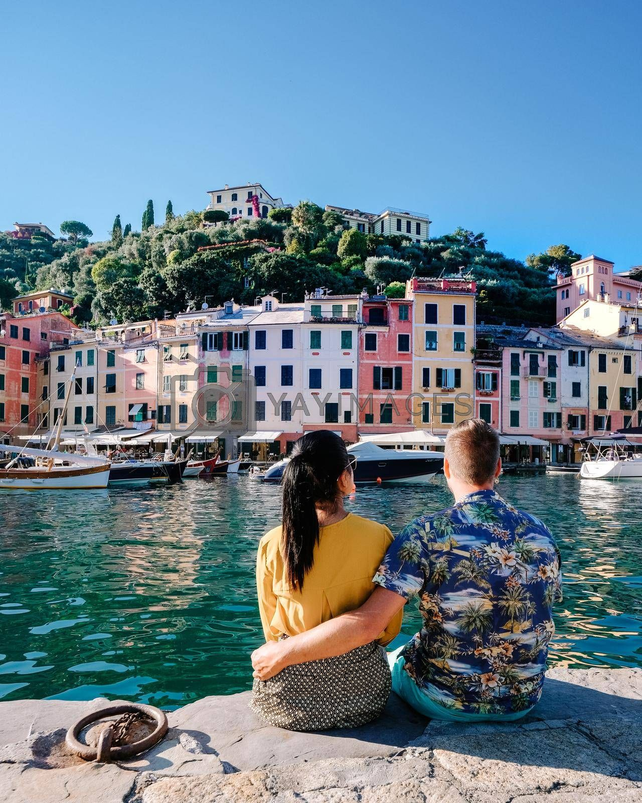 Portofino Liguria Italy, Beautiful bay with colorful houses in Portofino, Liguria, Italy.Europe, couple men and woman on vacation in Italy