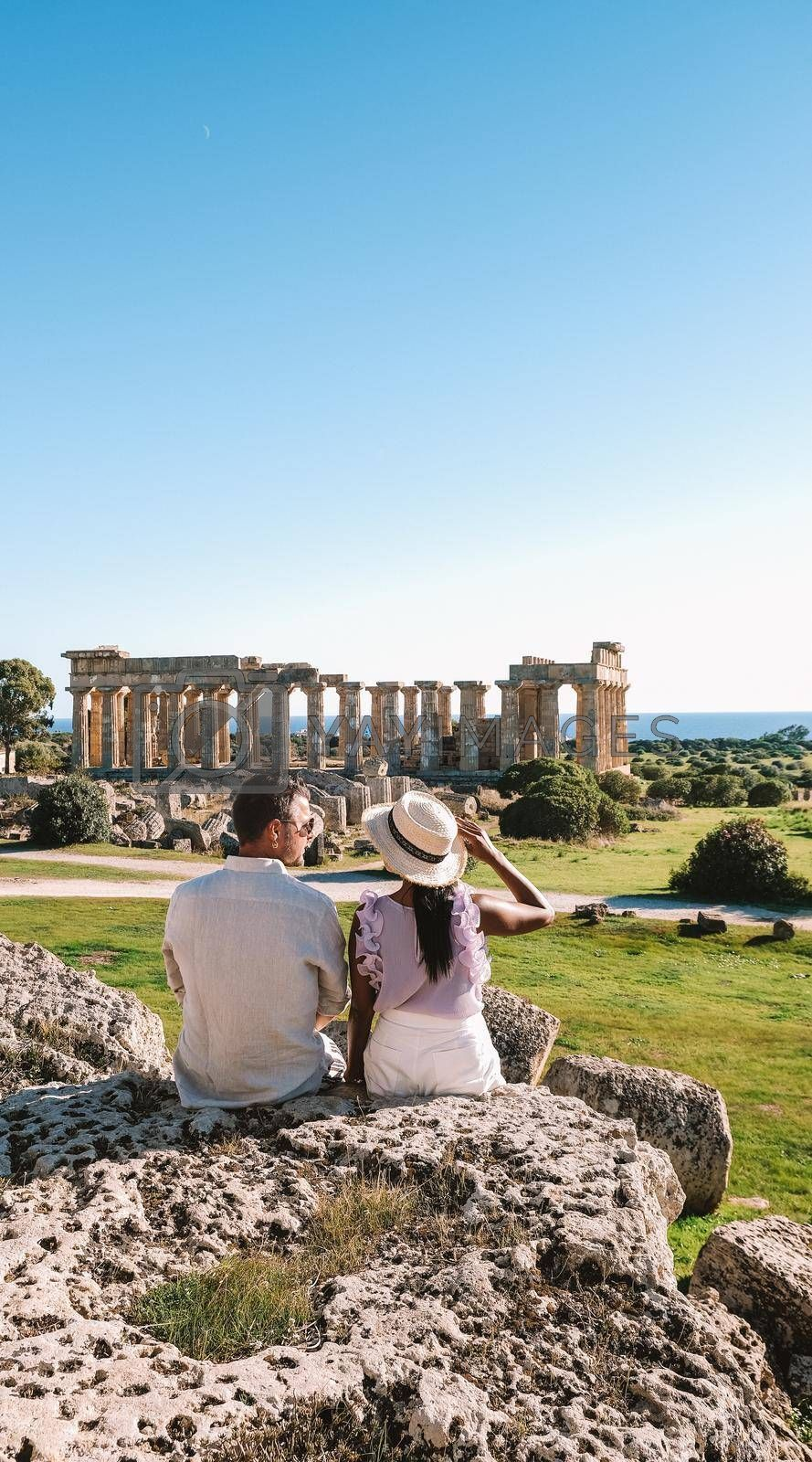 couple watch the old Greek temple in Selinunte Sicily Italy. Selinunte archeological site