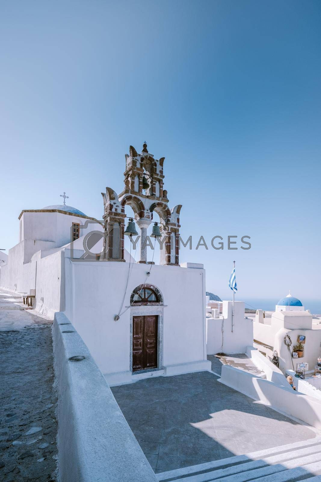 Pyrgos, Santorini, Greece. Famous attraction of white village with cobbled streets, Greek Cyclades Islands, Aegean Sea. High quality photo