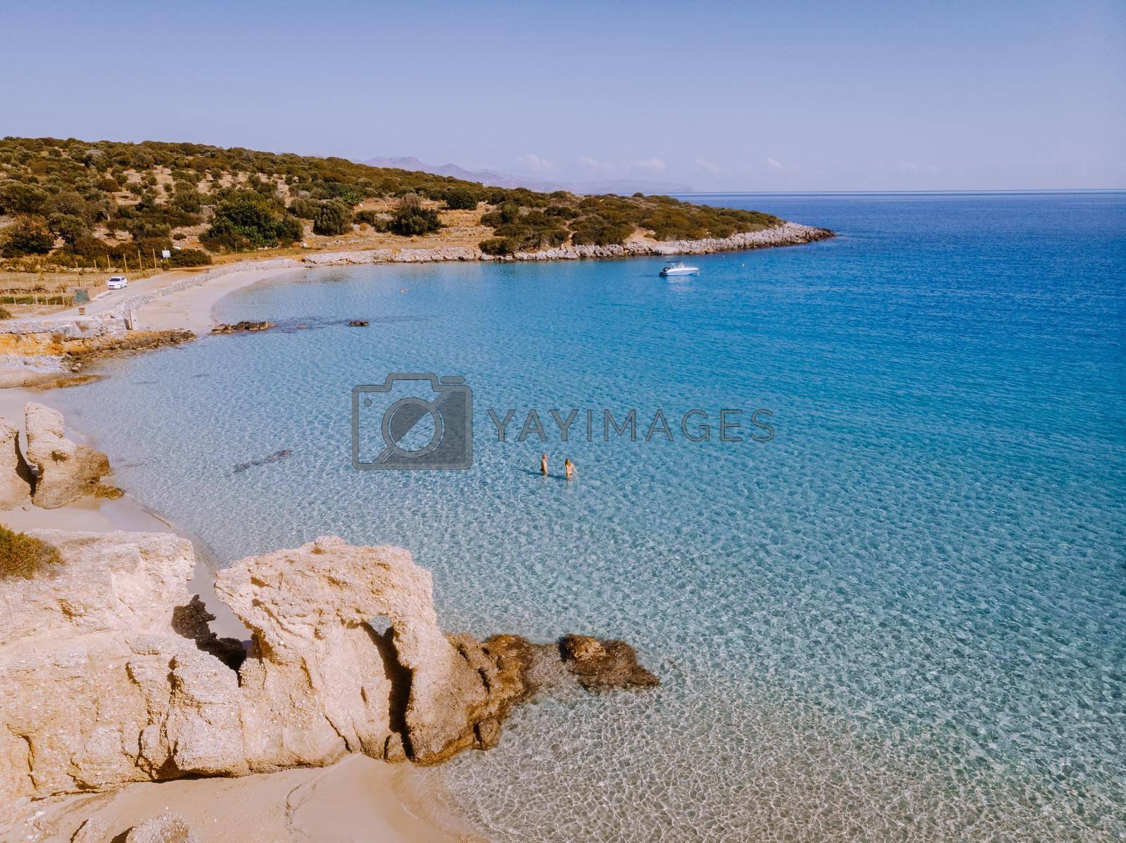 Tropical beach of Voulisma beach, Istron, Crete, Greece ,Most beautiful beaches of Crete island -Istron bay near Agios Nikolaos drone aerial view